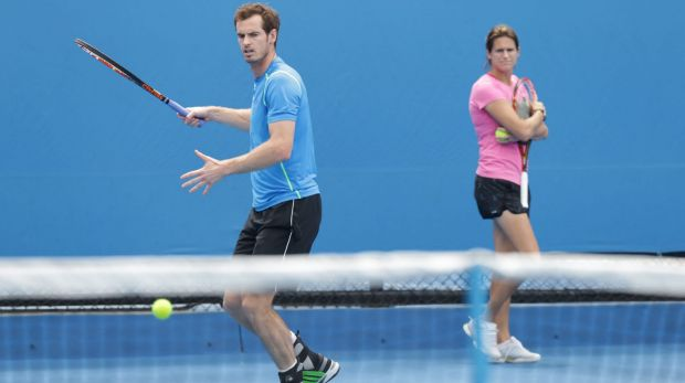 Andy Murray practises at Melbourne Park on Tuesday as his coach, Amelie Mauresmo, watches.