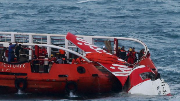 Stalled before crashing ... Indonesian search and rescue personnel pull wreckage of AirAsia flight QZ8501 onto the Crest ...