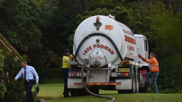 A septic service truck at the property in the search for the toddler.