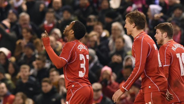 Sterling gold: Liverpool's Raheem Sterling celebrates his goal against Chelsea.