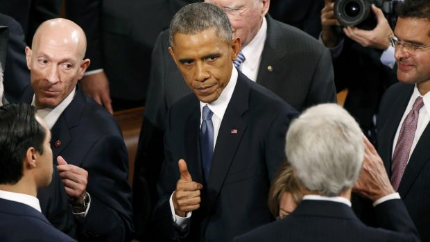 Searching for a legacy: President Barack Obama gives a thumbs up to Secretary of State John Kerry after his State of the ...