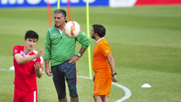 Iran coach Carlos Queiroz runs his eye over training at McKellar Park in Canberra.