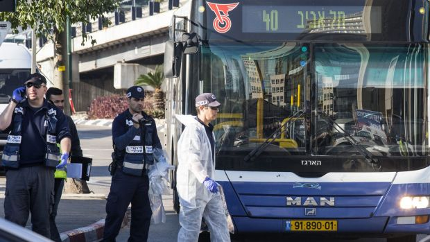 Israeli forensics examine the scene of an attack after a Palestinian man stabbed at least 12 people on a Tel Aviv bus on ...