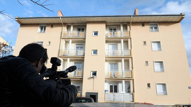 A man films a building in Beziers, where a Russian Chechen suspected of preparing a terrorist attack was living before ...