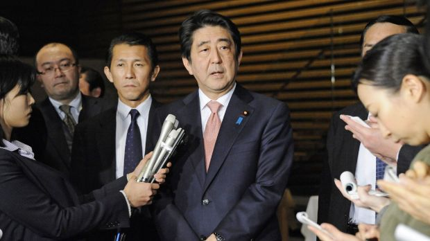 Shinzo Abe speaks to reporters at his official residence on Wednesday after a five-day Middle East trip.