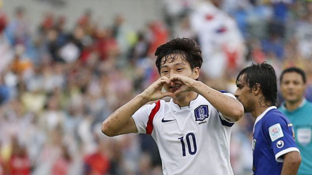 South Korea's Nam Tae-hee (L) celebrates his goal against Kuwait at Canberra stadium on January 13.
