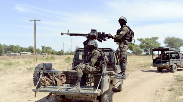 Cameroonian soldiers on patrol in Amchide, northern Cameroon, 1 kilometre from Nigeria.