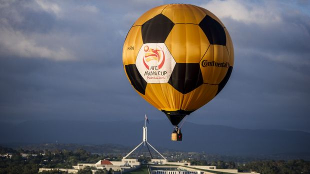 The Asian Cup hot air balloon flying over Canberra on Thursday morning.