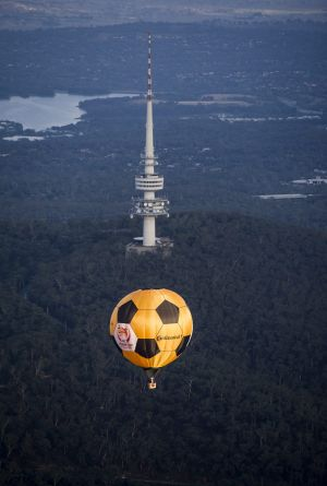 The Asian Cup hot air balloon flying over Canberra on Thursday morning