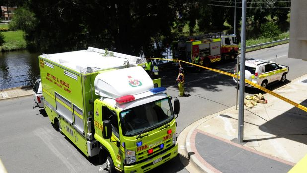 A suspected spill into Queanbeyan River has closed roads.