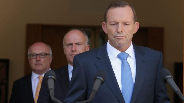 Seeking an election trigger? Prime Minister Tony Abbott with senators Eric Abetz and George Brandis.