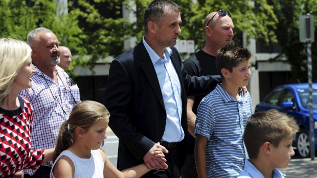 Free: Krunoslav Bonic walks from the ACT Magistrates Court, surrounded by family and supporters.
