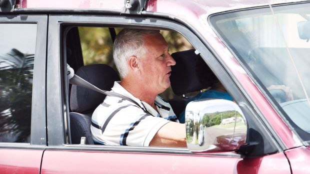 Denies involvement: William Spedding drives up to a friend's house this week.