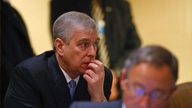 Britain's Prince Andrew, pauses during a break in sessions on day two of the World Economic Forum (WEF) in Davos, ...