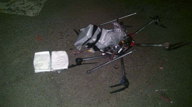 The drone loaded with packages containing methamphetamine lies on the ground after it crashed into a supermarket parking lot.