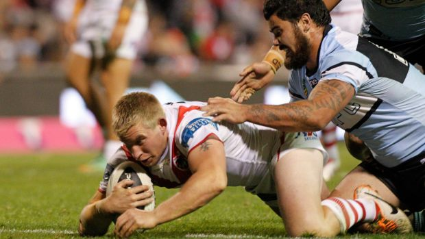 Rare four-pointer: Mike Cooper scores for the Dragons against Cronulla last year.