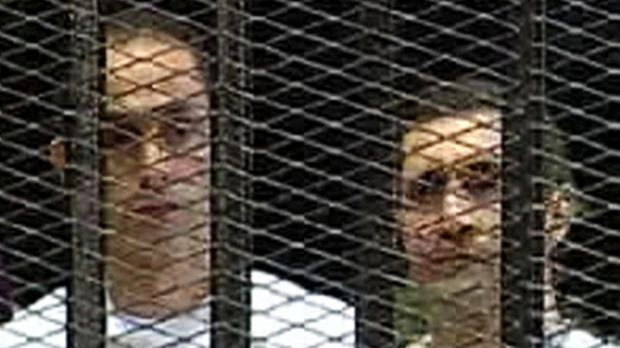 Gamal, left, and Alaa Mubarak  in court during their trial in 2011.