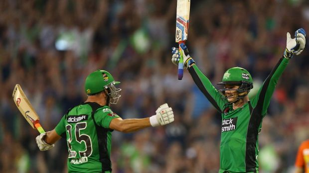 Peter Handscomb (right) of the Melbourne Stars celebrates with teammate Scott Boland, after scoring the winning runs and ...