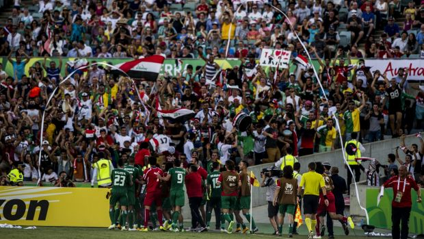 Great stadium, electric atmosphere: Iraq celebrate scoring a goal during extra time against Iran.
