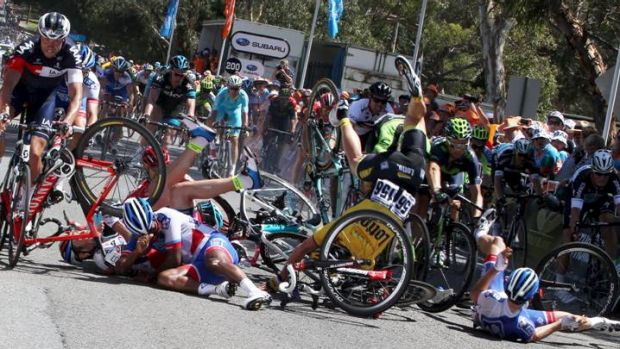 They all fall down: A group of riders take a tumble near the finish of Friday's stage of the Tour Down Under.
