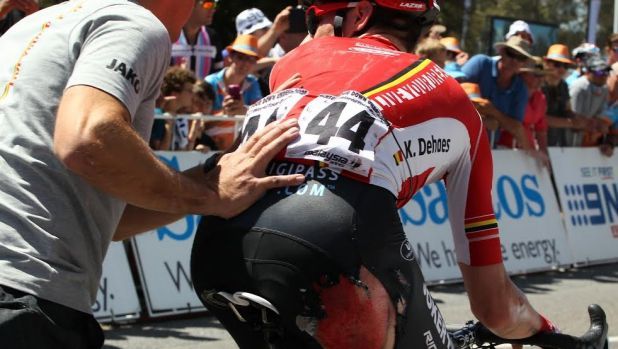Ouch: Blood drips off Kenny De Haes after Friday's mass crash.