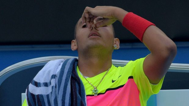 Nick Kyrgios waits to receive treatment for a nosebleed during his third-round match against Tunisia's Malek Jaziri on ...