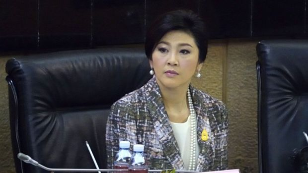 Ousted Thai prime minister Yingluck Shinawatra looks on as she faces impeachment proceedings by the military-stacked ...