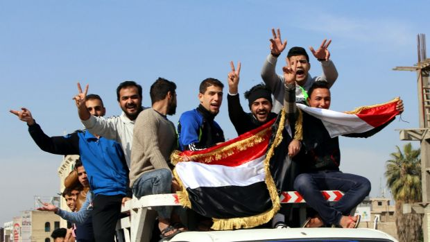 Iraqis take down to the streets of Baghdad to celebrate Iraq's penalty-shootout win over Iran in Canberra.