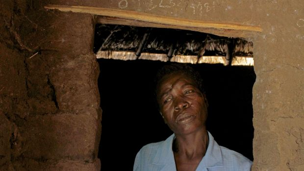 Attacked for using 'witchcraft' ... Mage Benge stands in the doorway of her home in the village of Magu in Tanzania's ...