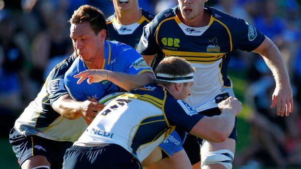 David Pocock tackles Force player Dane Haylett-Petty.