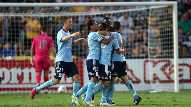 Dominant: Sydney FC players celebrate scoring against the Mariners on Saturday night.