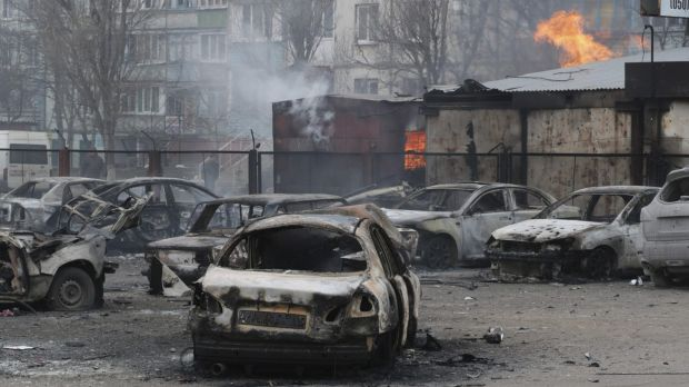 Burned cars in a residential area in Mariupol, Ukraine after a crowded open-air market came under rocket fire on ...