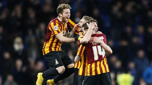 Bradford City players celebrate winning against Chelsea after their FA Cup fourth-round match at Stamford Bridge in ...