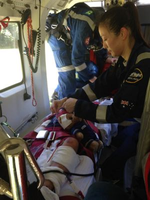 CareFlight's Dr Sunny Yoo treats one of the injured children before flying to Westmead.