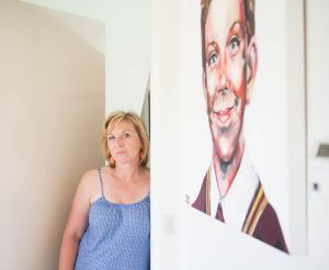 Rosie Batty earlier this month with a portrait of her beloved 11-year-old son Luke. She says his father, who killed him, ...