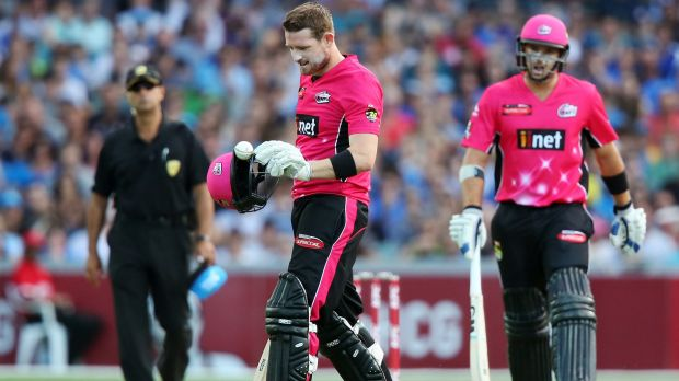 Close call: Riki Wessels of the Sydney Sixers takes off his helmet after a ball bowled by Kane Richardson hit him and ...