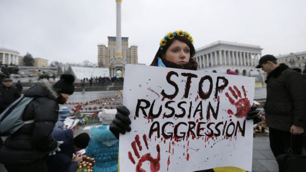 A woman holds a placard during a rally on Independence Square in Kiev on Sunday.