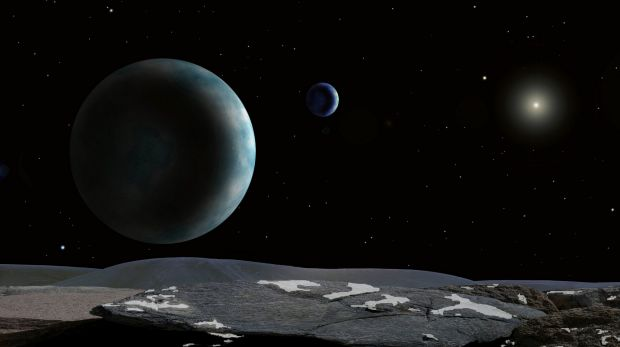 An artist's impression at the Harvard-Smithsonian Centre for Astrophysics shows Pluto and its moon Charon as seen from ...