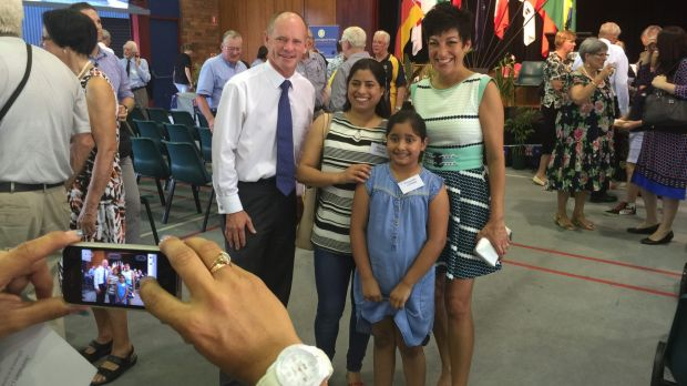 Campbell and Lisa Newman with the Lohani family at The Gap State School.
