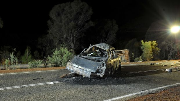 The rolled Mazda in the background flipped after colliding with this burnt out Holden Commodore