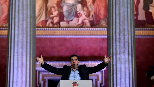 Syriza leader Alexis Tsipras hails his party's victory outside Athens University on Sunday night.