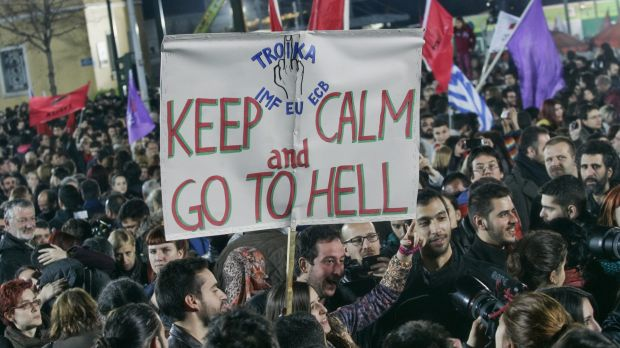 "Syriza supporters make their feelings about the ""Troika"" managing Greece's bailout clear."