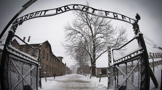 The entrance to the former Nazi concentration camp Auschwitz-Birkenau with the lettering 'Arbeit macht frei' ('Work ...