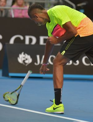 Nick Kyrgios smashes his racquet in frustration during his match against Italian Andreas Seppi.