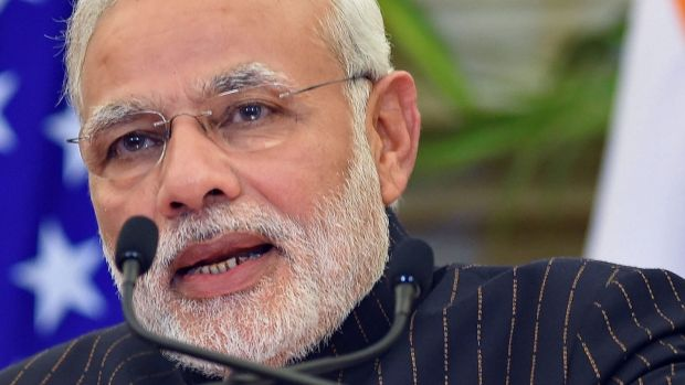 Indian PM Narendra Modi, seen wearing a suit bearing his own name, speaks during a joint press conference  with US ...