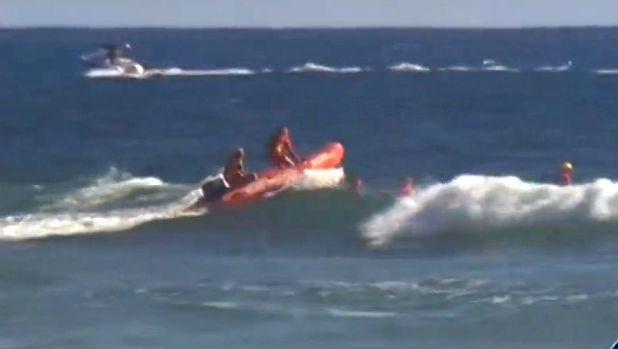Crews search for the swimmer in the wake of his disappearance.
