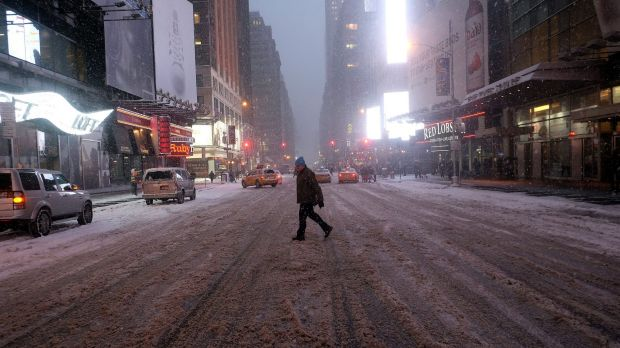 Deserted: A man crosses Times Square in New York during the blizzard.