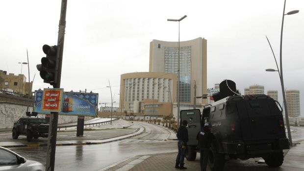 Security forces take up positions around Corinthia Hotel in Tripoli after it was attacked by gunmen.