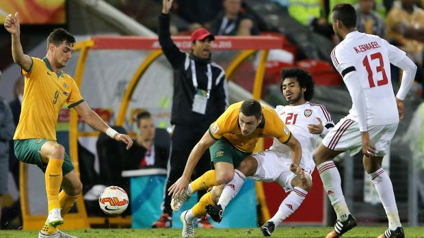 Socceroos Tomi Juric and Mathew Leckie scrap for the ball with United Arab Emirates players in the semi-final.