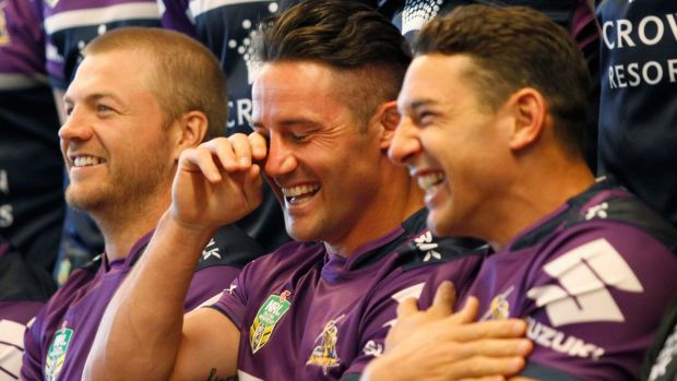 This is serious, Melbourne: Cooper Cronk shares a laugh with Ryan Hinchcliffe and Billy Slater at the team photo shoot ...